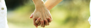 Couple with UK marriage visa hold hands